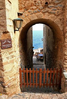 A gate to relaxation & the sea Walking inside the castle, Monemvasia Greece Art & Architecture Author: karyatida Santorini, Mykonos, Oh The Places You'll Go, Places To Travel, Places To Visit, Dark Places, Albania, Monemvasia Greece, Beautiful World