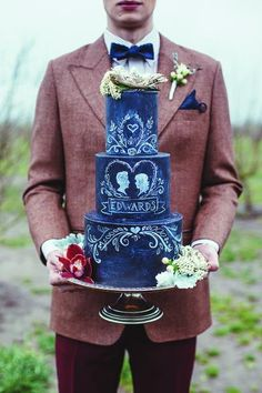 Show your creativity with a chalkboard cake. Chalkboards are getting popular in wedding decor, why not take it to the next level. Credit: Hazelwood Photo