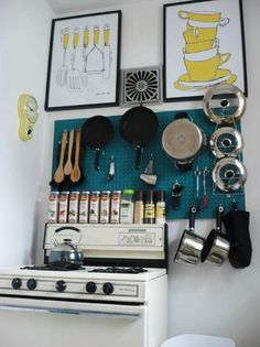 LOVE me some peg board.  It's a great way to maximize wall space in a tight kitchen.