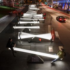 A design team including Lateral Office and CS Design has created a Montreal installation that consist of glowing seesaws and hypnotic video projections
