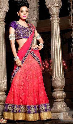 Look stylish wearing this fuchsia net embroidered lehenga cholie. The amazing choli creates a dramatic canvas with unbelievable patch, resham and stones work.  #NetLaceWorkLehengaCholi