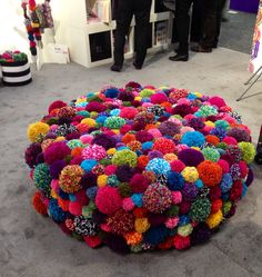Spotted this oversized ottoman festooned with pom-poms at Toy Fair 2014. No link, just photo.