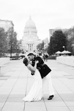 John and Sarah share a kiss on Olin Terrace in front of Monona Terrace. Photo captured by Molly Jo Collection.
