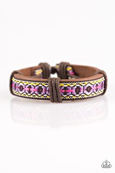 Mojave Trails - Multi Bracelet - $5  Pink, white, and yellow thread is stitched into a colorful textile pattern. Shiny brown cording knots around the tribal pattern, securing the colorful ribbon in place along a rustic leather band for an urban look. Features an adjustable sliding knot closure.  Sold as one individual bracelet.
