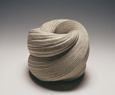 Sakiyama Takayuki (b. 1958) creates irresistible vessels that are carved with rippling surface patterns that reinforce their surging, spiraling nature yielding objects that are sensuous, bold and seamless. Some works appear as if made from sand on the beach, the surface simply decorated by the current of the receding water. Others appear to undulate and twist in space as if in perpetual motion. His work has been selected for an exhibition posters at the Metropolitan Museum of Art.