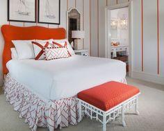 vertical orange pinstripes on wall in bedroom