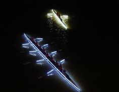 boats lighting up the water with lights at night. AWESoME --> Need it for Riverbend and awesome night rows!