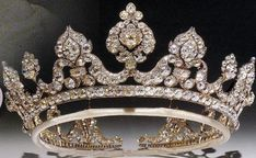 Londonderry Diamond Tiara (Garrard 1854). At one time, each individual element was set with a pearl, but these have been replaced by diamonds and its original gallery of pear-shaped pearls has also been removed. The diamond parure was made from stones removed from the jewels and second Garter insignia of the Marchioness Emily.