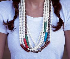 Chumana Necklaces made with colorful African snake beads.