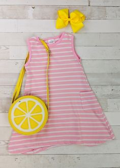 """Pink striped tank dress with pockets. Pairs perfectly with our lemon purse for a fun """"pink lemonade"""" summer look. Any accessories shown are not included. Toddler Boutique Clothing, Wholesale Children's Boutique Clothing, Girls Boutique, Cut Out Leggings, Denim Overall Dress, Cute Girl Outfits, Pink Lemonade, Striped Tank, Toddler Dress"""