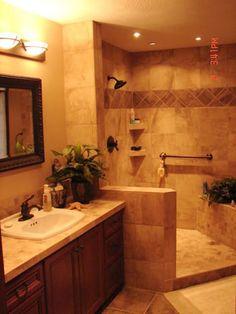 Build shower in corner, move vanity to existing vanity/shower area.  Tub in windowseat area???