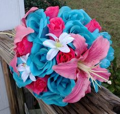 This listing is made to order and Includes 1 10in Round Malibu Blue & Hot Pink Rose Wedding Bouquet with Coral Pink Tiger lilies and mini white accent tiger lilies. Choose your ribbon color from Pic 2