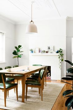 Modern retro dining room from an Art Deco apartment in Melbourne. Photo: Martina Gemmola | Styling: Lucy Glade-Wright | Story: real living