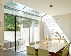 glass sloping roof and doors in kitchen dining area