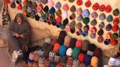 """A local hatmaker selling his goods on the edge of the ramparts in Essouira, Morocco."""