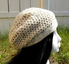 Wheat. This soft slouch hat is light weight but made out of wool. Mostly cream in color it has a thread of black and brown through out. Available to order @ facebook.com/hooka.yarn