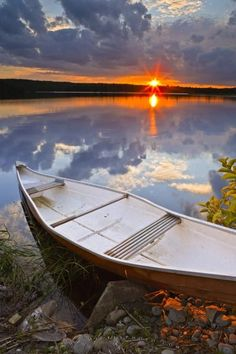 Beautiful photo of a canoe on the banks of the St. Mary's River at sunset in Sherbrooke, Nova Scotia.