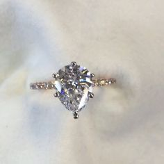 A tear drop of joy... A classic pear cut diamond center stone on an eternity band. A custom made engagement ring for a beautiful lady