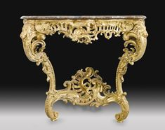 A CARVED GILTWOOD CONSOLE TABLE, LOUIS XV, MID 18TH CENTURY.
