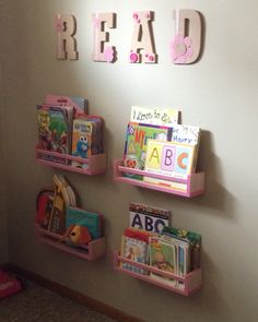 My twist on the IKEA Reading Nook. I bought IKEA spice racks and painted them pink. Then I found the letters and burlap flowers at Walmart. Everything else, I had laying around. All for under $30! Ikea Spice Rack, Spice Racks, Burlap Flowers, Big Girl Rooms, Reading Nook, Evie, Room Ideas, Walmart, Letters
