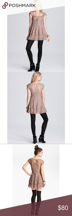 Free People Rock Candy Lace Dress in Taupe Pink Layers of raw-edged lace lend a romantic, undone feel to this fit-and-flare dress from Free People. Ruched seams accent the sweetheart neckline, and the sheer yoke and sleeves show a veiled swath of skin. A keyhole closure fastens at the back. Side seam zipper closure. Fully lined. Shell: 100% nylon. Lining: 100% rayon. Free People Dresses Mini