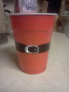Santa Claus Suit Red Solo Cup for Christmas Parties ~ There isn't a link for this because it's so easy. All you need is a red solo cup, electric tape, and a pop top off of a can. Just weave the tape through the top and stick it onto the cup! Super easy and cheap!! Have Fun!!