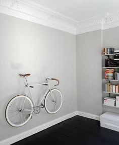 Roundup: 10 Stylish Bike Storage Ideas that Double as Decor Bike Hanger Wall, Bicycle Hanger, Bike Hooks, Bike Storage Systems, Bike Storage Solutions, Modern Interior Design, Interior Design Living Room, Scrambler Custom, Bike Design