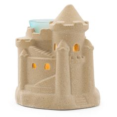 Sun and sand are fleeting, so bring the shore indoors with Summer Sandcastle, a year-round homage to sweet summer fun.