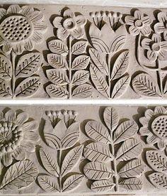 Fiori e foglie in rilievo