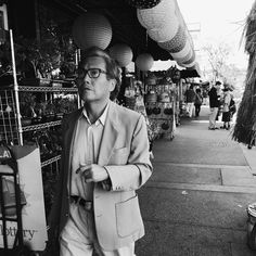 A shopper strolls along New High St. in Chinatown. @americanobscura for @streetvogs