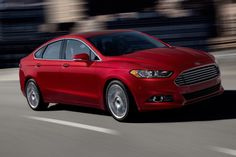 The 2013 Ford Fusion has a serious case of Aston Martin envy.