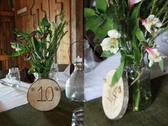 Use a circular saw to make round pieces of wood, then using a burning tool from a local craft store to burn in table numbers. Attach twine, put around a mason jar filled with flowers or other table topper of your choice.