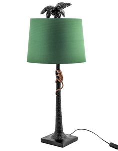 10 Of The Best Nature Inspired Table Lamps | A subtle but intricately detailed lamp in the form of a palm tree with its very own gold climbing monkey. #tablelamp #monkeylamp #lightingdesign #lightingideas #hometrends #interiortrends #homedecor #interiorinspo #inspiredlighting #lightingtrends #interiordesign