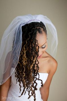 Long locs braid-out swept to the side with flat twists. Photo by The Natural Bride, used by permission.