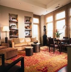 Here An Oriental Rug Ties Together Dark Wood African Decor Seamlessly.