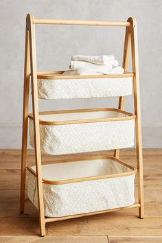 Small bathroom or tiny bedroom? A tiered shelf or basket is the perfect vertical storage for any small space. This tiered bamboo shelf is the three-in-one solution to DIY a linen closet where there isn't one, or store toilet paper instead of hiding it. #affiliate.