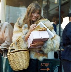 Jane Birkin looking flawless in a fur coat and carrying a basket bag