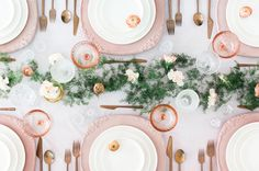 pink table chargers with a whimsical light pastel floral runner // easter tablescape
