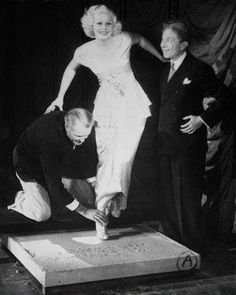 Jean Harlow, with friends, leaving her footprints, Grauman's Chinese Theater.