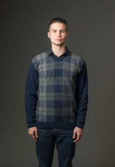 This is a great weekend or work-wear jumper for men with a crew neck and a modern Tartan Plaid pattern. The knit blend is soft and light-weight for every-day wear. This jumper is perfect to wear over a shirt at work.