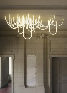 LOVE THIS - This is 'Les Cordes' chandelier by French designer Mathieu Lehanneur. A ceiling light like a rope or a network of light which appears to cross the ceiling. It illuminates the interior of Château Borély, in the southern part of Marseille.
