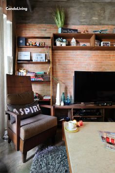 in this Couple's Rustic Industrial Condo Flipped By An Artist Rustic Industrial, Man Cave, Corner Desk, Condo, Couple, Artist, Furniture, Home Decor, Corner Table
