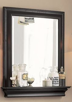 DIY-Mirror, like this in white with the shelf along the bottom, gets things up off the bathroom counter. cute for entryway too with hooks underneath