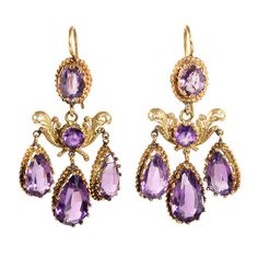 French Amethyst Girandole Drop Earrings. Restoration period amethyst & 18k gold drop earrings in a classic girandole form. French in Origin with full hallmarks. Circa 1815.