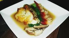 Seabass, artic calms on a bed of bok choy and shiItake mushrooms.