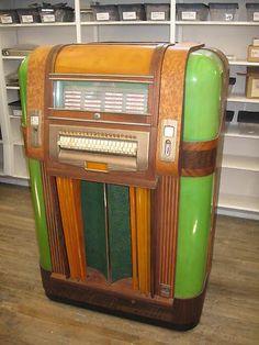 "Handsome 1940 Mills brand ""Throne of Music"" Jukebox, with jadite green plastic panels."