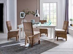 New Nordic interior featuring white floor boards, rattan furniture and neutral walls. Furniture from the Provence range from Novasolo Nordic Interior, Gray Interior, Interior Design, Dining Chair Set, Dining Table, Dining Rooms, Provence, Wooden Box Centerpiece, Rustic Wooden Box
