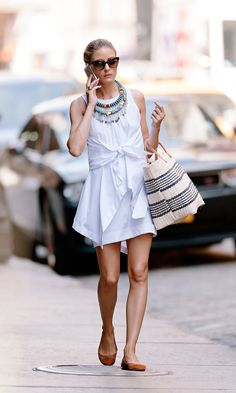Love Olivia Palermo's unique knot-front shirtdress? Her exact Alexander Wang find is long sold out, buy you can easily fashion your own take on the piece by tying any white button-up around the waist of your favorite white shift, sheath or fit-and-flare number. (Plus, you'll then have an extra layer on hand for breezy summer nights!)