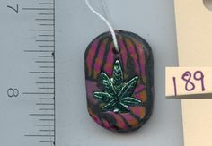 Knotty PEACEs Artwork. Pendant made from Polymer and Fimo Clay One of a Kind available for purchase KP-P-2-189
