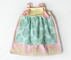 Touch of Whimsy Apron Knot Dress - sizes 9 mth to 5. $38.00, via Etsy.